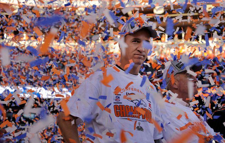 Denver Broncos quarterback Peyton Manning (18), takes in the moment with Denver Broncos head coach John Fox, right, as the ...  #ProFootballDenverBroncos