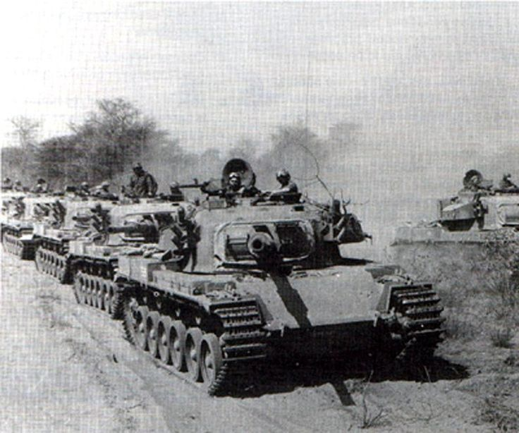 """A column of heavy tanks, """"Olifant"""" whilist the South African sun comes to Angola, 1988. Photos of the South African magazine """"Paratus""""."""