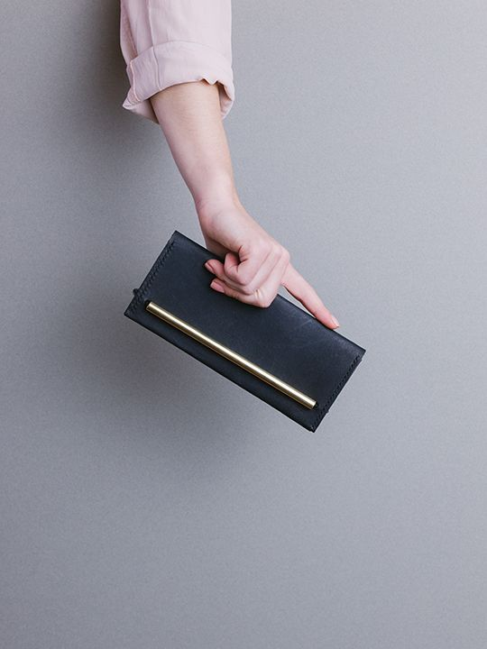 Symmetry collection by Georgie Cummings  Flip wallet in black