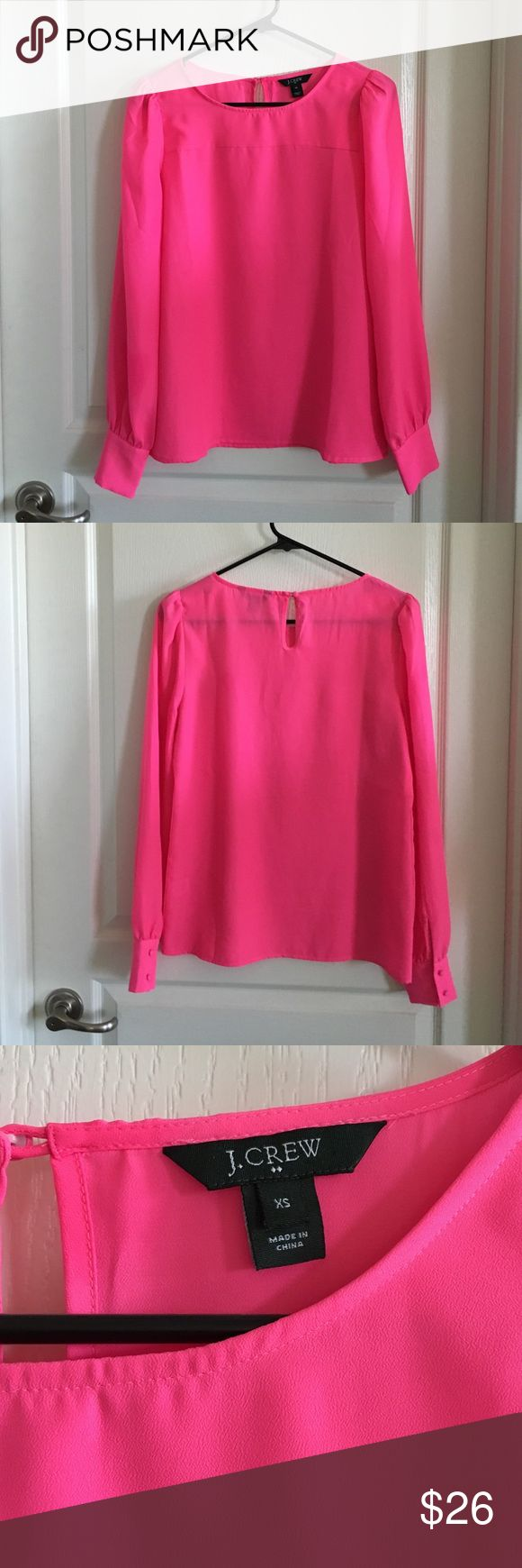 J Crew Factory Hot Pink Blouse Size XS Pretty elegant blouse in hot pink. Has key hole button in back, 2 buttons at each cuff and puff sleeves. 100% polyester. Last pic is a stock photo in a different color. Worn a few times, but still in excellent condition. No trades or Paypal. J.Crew Factory Tops Blouses