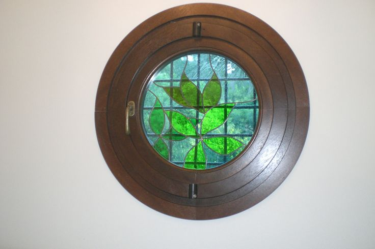 Porthole pivot window with special artistic glass