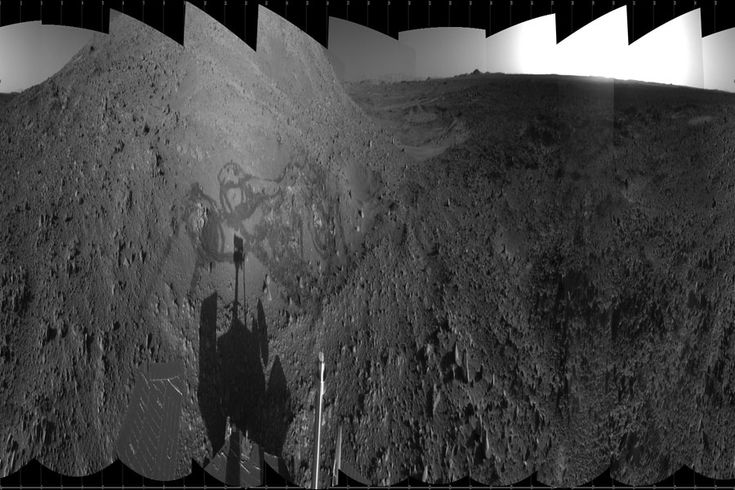 March 2010 Spirit Rover at Engineering Flats on Mars Credit: Mars Exploration Rover Mission, JPL, NASA This panoramic picture, created in 2004 and shown above compressed horizontally, was mostly unintentional -- the MERS team was primarily instructing Spirit to investigate rocks in and around Hank's Hollow in a location called Engineering Flats on Mars. After creating the ground display with its treads, the Spirit rover was instructed to photograph the area along with itself in shadow.