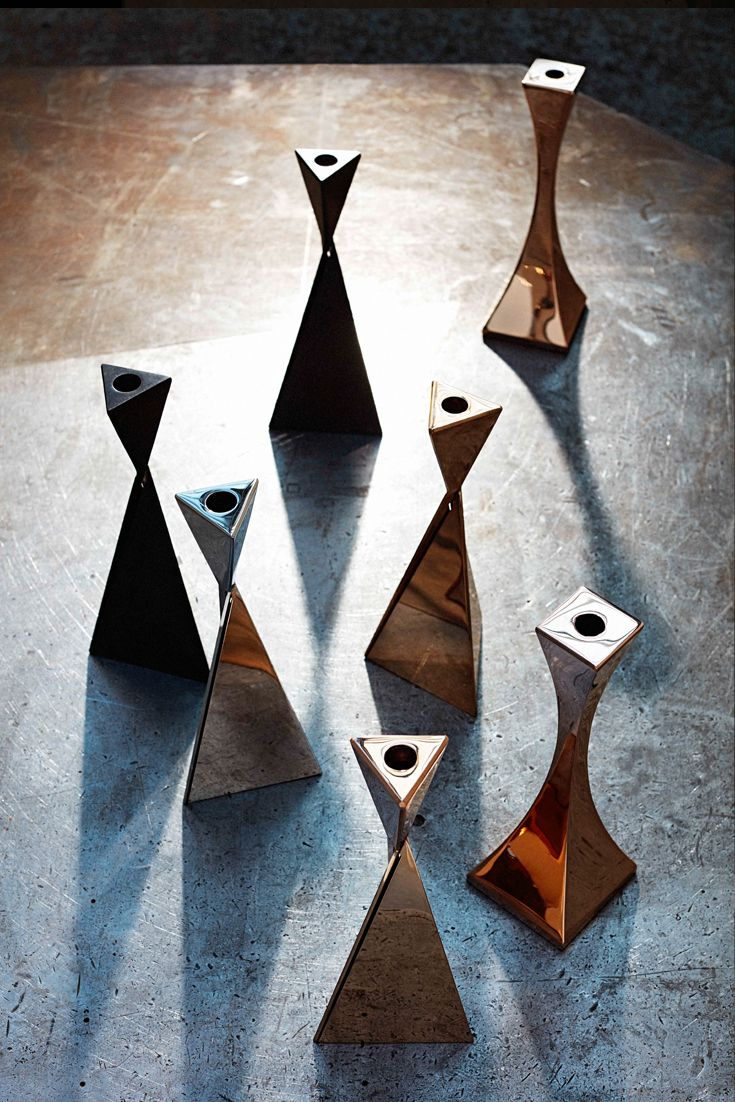 AVA & Capricorn #metal #candlesticks in #bronze, #steel with specialist finishes.