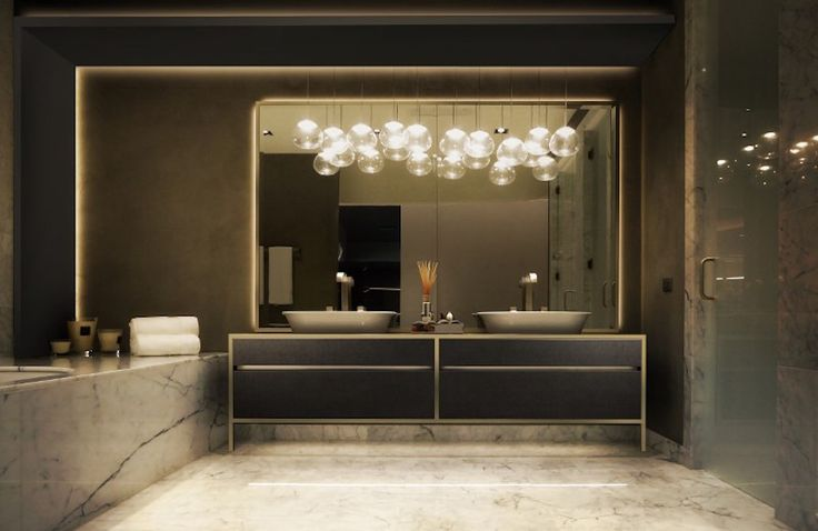 We can't forget about the noblest material for any bathroom design – marble. Beautiful modern bathroom connecting marble and modern designs of vanities, bathtub and lighting by Mirage. ➤To see more Luxury Bathroom ideas visit us at www.luxurybathrooms.eu #luxurybathrooms #homedecorideas #bathroomideas @BathroomsLuxury