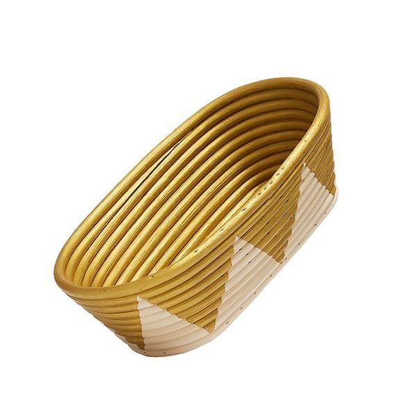 medium oblong rattan bowl with gold painted inside and gold zig zag design on outside