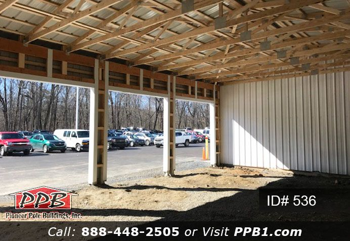 Four Car Garage With White Siding 32 W X 48 L X 14 6 H Id 536 4 10 X 10 Commercial Insulated Garage Doors Pole Buildings Diy Gutters Fibreglass Roof
