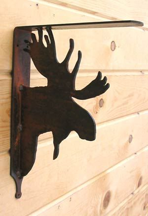 "Our rust finish metal shelf bracket features a Moose that will support a shelf 8"" or wider. The steel is rusted and has a clear coat finish applied to help prevent further rusting. Measures 11""H x 8 ""D when hung"
