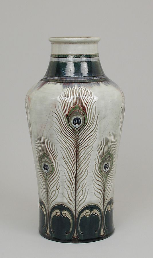 Vase with peacock feathers Delaherche 1889