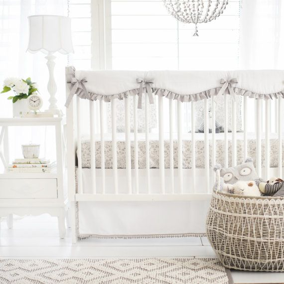 """Our white and gray bunny girl baby bedding is fun and colorful!  2 Piece includes Sheet & Skirt 3 Piece includes Sheet, Skirt, & Crib Rail Cover 4 Piece includes Sheet, Skirt, Crib Rail Cover, & Blanket  Our cotton crib sheets have elastic around all four corners and are fitted for a snug, secure fit. Sheets fit a standard size crib mattress, approximately 28"""" x 52"""". Coordinate with our assortment of crib skirts and other crib bedding items. Machine Washable. The White with Gray Pom Pom 17…"""