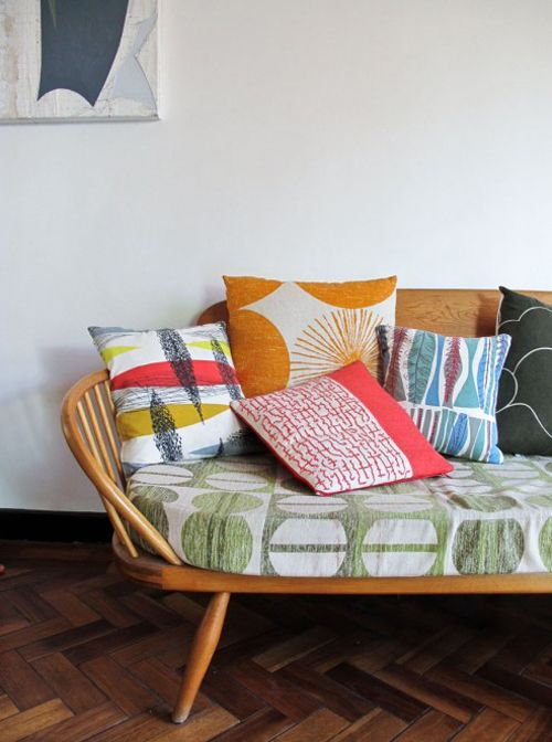 love the bench and the vintage fabrics!