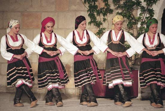Photograph:Greek women perform a folk dance.