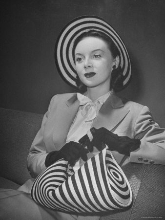 Michele Fallon wearing John Frederics striped straw hat & handbag, 1944, photo by Nina Leen.