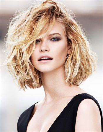 Medium length hair; tousled blonde wavy lob