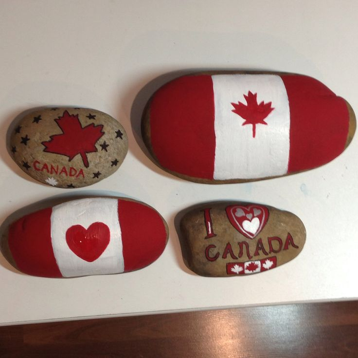 Painted by Michele Donohue, Canada Day painted garden rocks