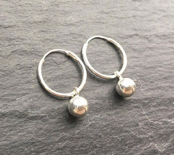17++ Hoop earrings with balls and spikes information