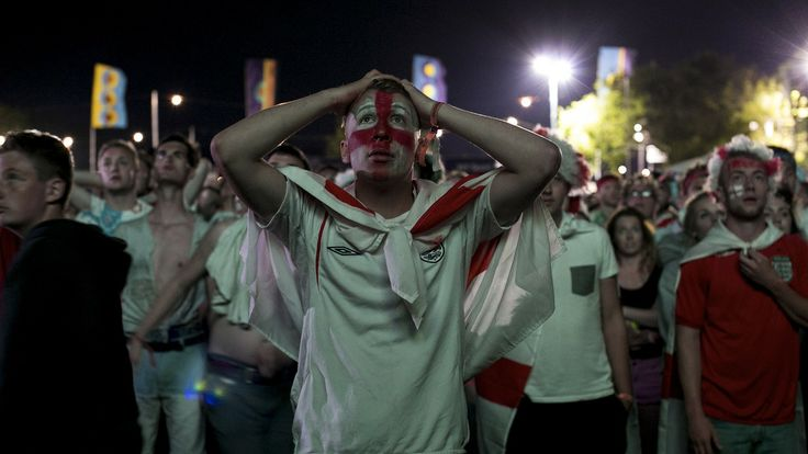 Football fans watch the first England game of the World Cup during the Isle of Wight Festival in Newport on the Isle of Wight on June 14. Despite a stronger appearance than is normal for the English national team, England lost 2-1 to the Italy team.
