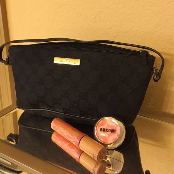 """Authentic Gucci purse Authentic Gucci bag! Black canvas with the Gucci emblem all over it. Length is 10"""". Please let me know if you have any questions  (lipstick and gloss not included) Gucci Bags Mini Bags"""