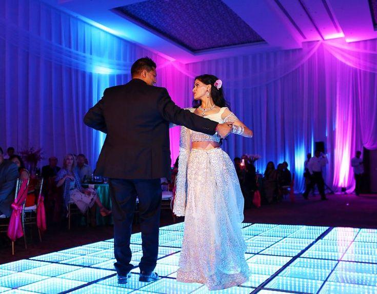 Nikita and Shashi on the dance floor at the wedding reception following their traditional Hindu wedding at Moon Palace Cancun