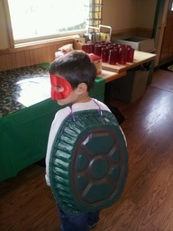 Teenage mutant ninja turtle costume for Reed?  Use a foil roasting pan sprayed green...