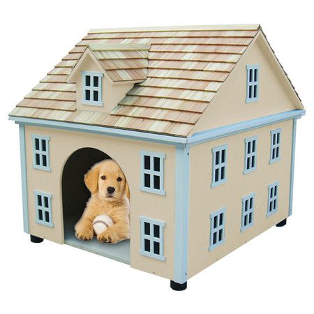 Colonial-inspired dog house in yellow with shingle detail. Product: Dog houseConstruction Material: Exterior grade ply...