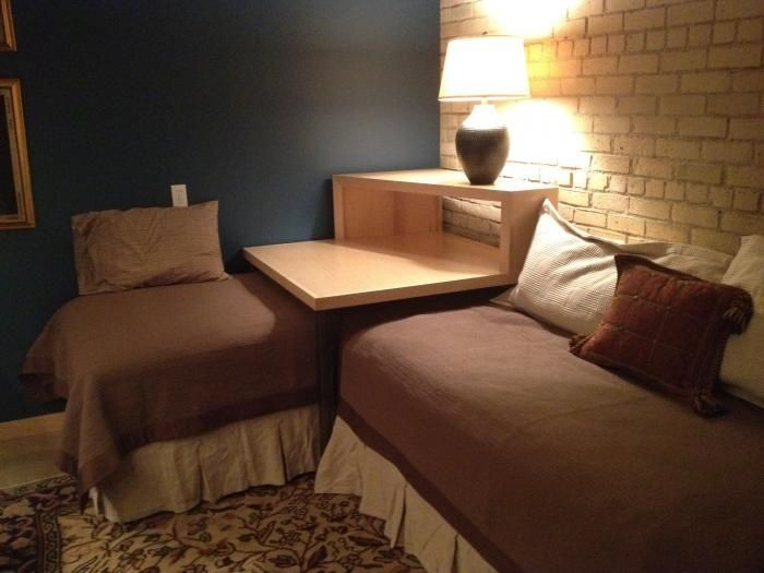 Corner Twin Beds with Table | This corner table converts two twin beds into a sleeping or lounging ...