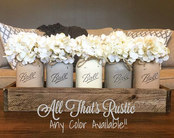 This listing is for a stunning and true rustic Ball Mason Jar centerpiece. This is perfect for your farmhouse decor or rustic decor. This is sure to make a wow statement to any home decor. It is also sure to make a truly unique gift for any occasion! This could also serve as a beautiful wedding centerpiece! Specs: -24.5L x 5W x 3H (9-10 in height with box, jars, and flowers) -shown is our neutral toned collection, but you can choose yours by mixing and matching your decor ;) Purchase…
