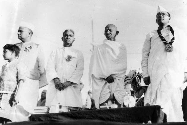 Members of the Indian National Congress (foreground left to right) Mahatma Gandhi (Mohandas Karamchand Gandhi, 1869 – 1948), Subhas Chandra Bose (1897 – 1945) and Vallabhai Patel (1875-1950) during the 51st Indian National Congress.