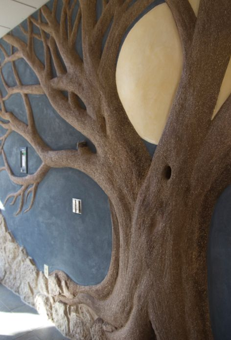 Clay plaster walls  made by molding the material to create bas-reliefs/high-reliefs and add a sculptural quality walls.