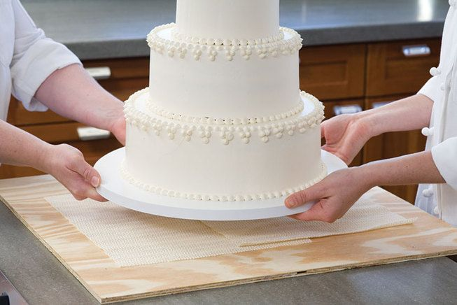 Step by step instructions in putting a tiered wedding cake together and some decorating ideas.