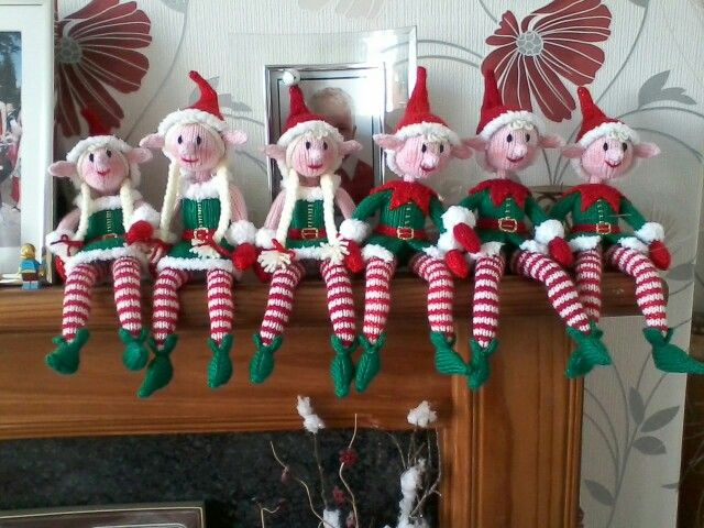 Hand knitted elves of a shelf