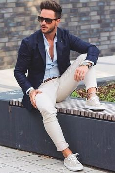 Men's Navy Vertical Striped Blazer, Light Blue Dress Shirt, Beige Chinos, Beige Low Top Sneakers. Black Sunglasses