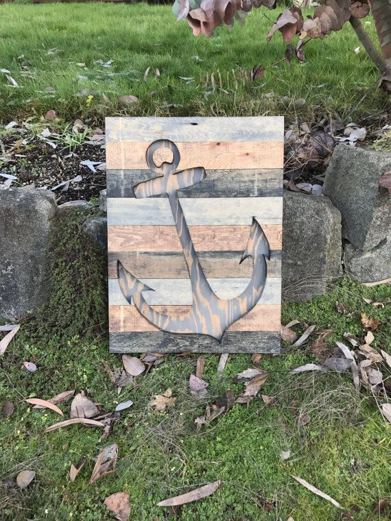 This rustic nautical wood anchor silhouette wall art is made out of pine uniquely stained to look like rustic reclaimed wood. These colors give this piece a rustic modern look. This piece measures 23x17 and is preinstalled with hanging on the wall. This piece is available to be made in different sizes and with a different assortment of colors. Just message me for details.  **NOTE - This piece is made to order. The picture displayed is the template and will be the same design but may have dif...