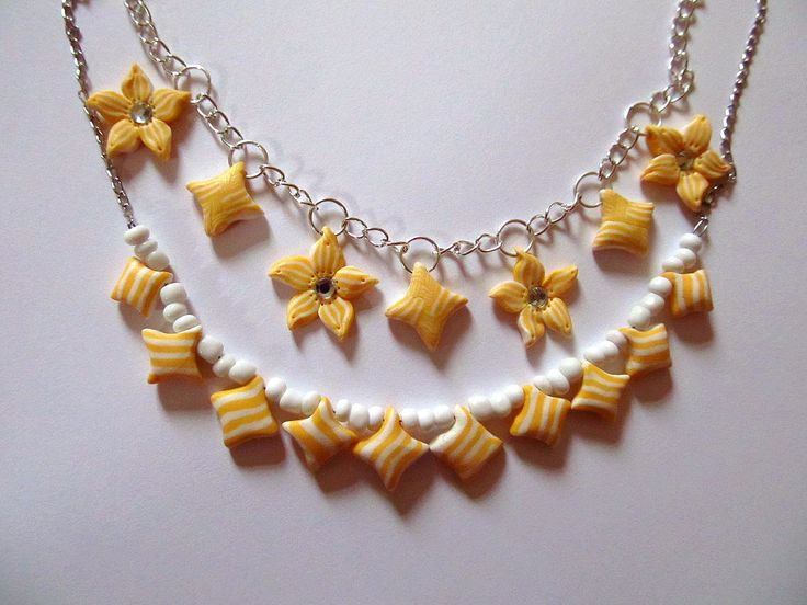 Necklace with yellow flower medals #clay