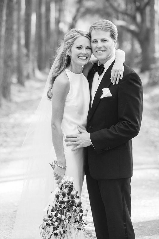 Cameran Eubanks and Dr. Jason Wimberly on hugging on wedding day http://itgirlweddings.com/cameran-eubanks-southern-wedding/
