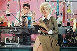 Jerry Lewis as The Nutty Professor, with the object of his affections, the lovely Stella Stevens, in the foreground    https://famousclowns.org/famous-clowns/the-nutty-professor/