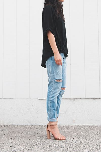 oversized black tee, distressed boyfriend jeans, and a great nude leather sandal
