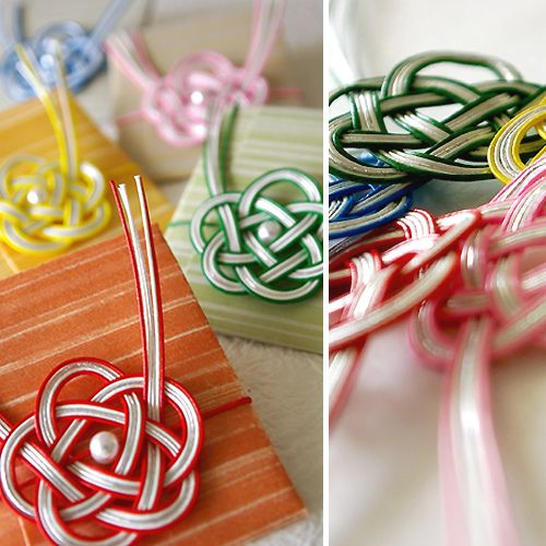 handmade cards ... mizuhiki flower knots with coordinating colors of striped paper ....