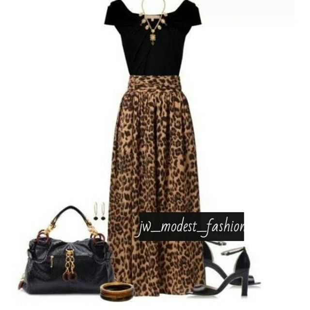 Black blouse with a long leopard print skirt.
