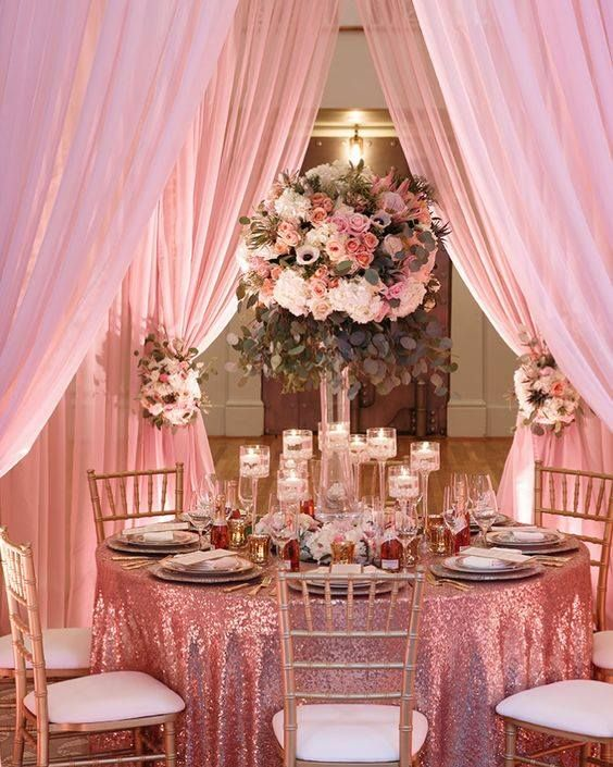 Shimmering Pink Tablecloth Reflects Candlelight In A Wedding