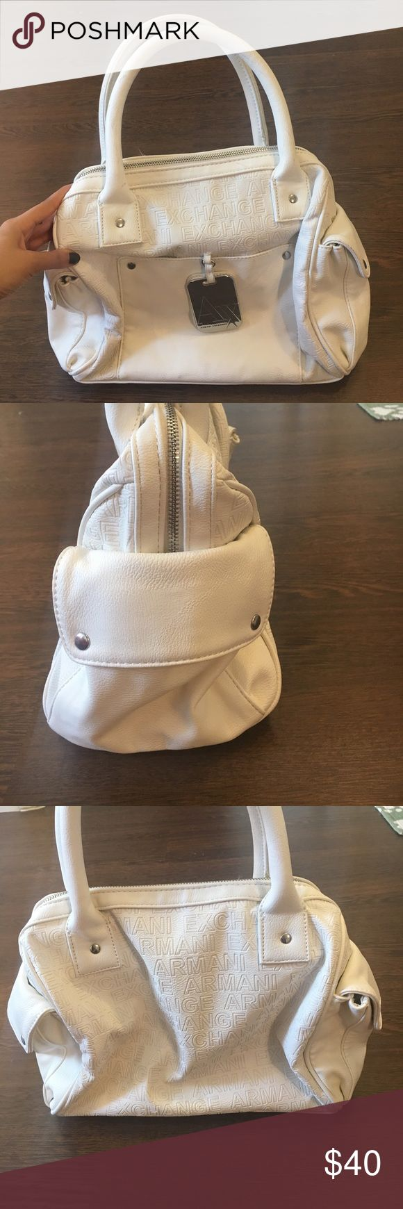 Armani Exchange White Purse Brand new never used Armani Exchange A/X white purse. Inside is perfect no stains. Outside has damage as pictured from sitting in a box. AS IS. A/X Armani Exchange Bags
