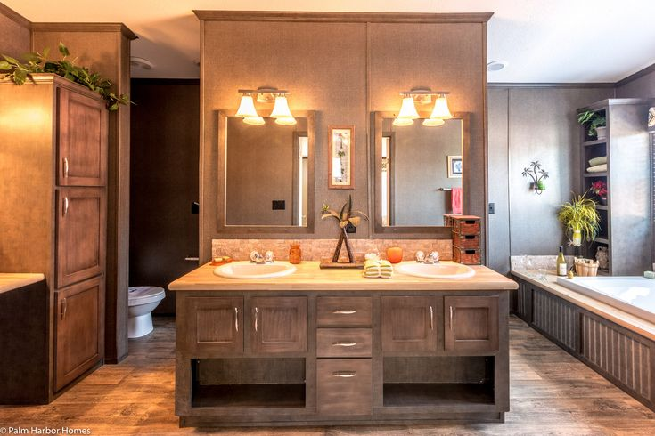The master bath in The Magnum by Palm Harbor is, in a word, magnificent. Double sinks plus a vanity area and an oversized bath and shower plus additional closet space and more in he Magnum Home 76 double wide manufactured home by Palm Harbor Homes.
