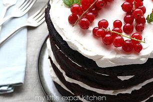 Naked chocolate layer cake with vanilla chantilly cream