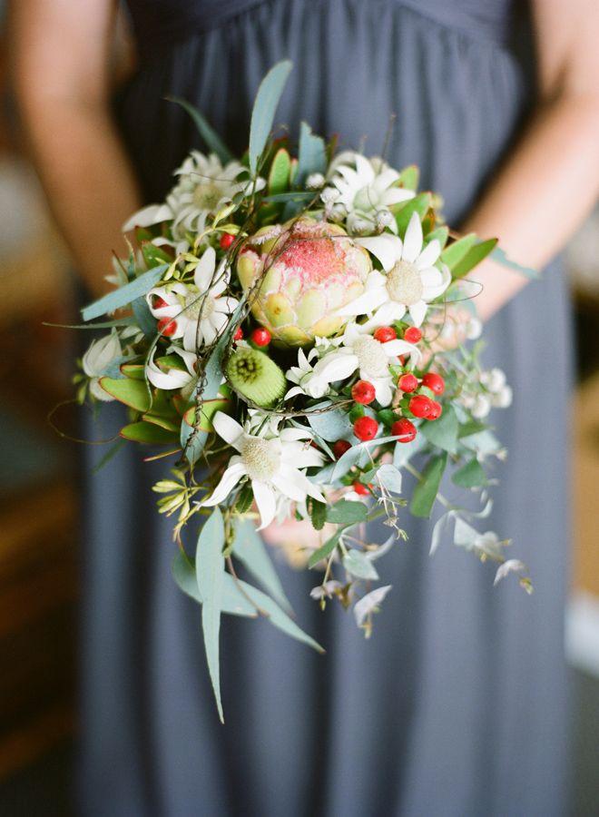 Petite style native design featuring smoky Joe Protea, flannel flower, berries, leukadendron and vine.