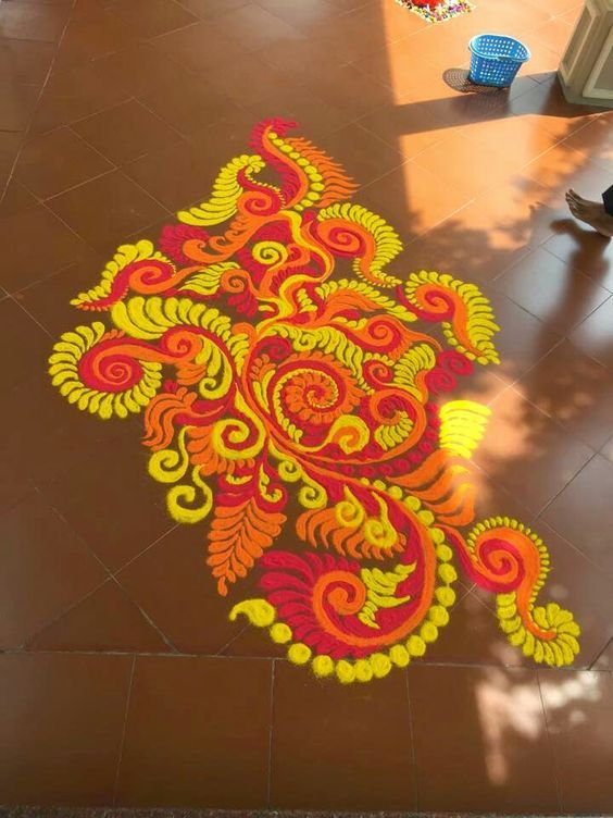 Lead the way to His pandal with a small and colourful rangoli that stands out