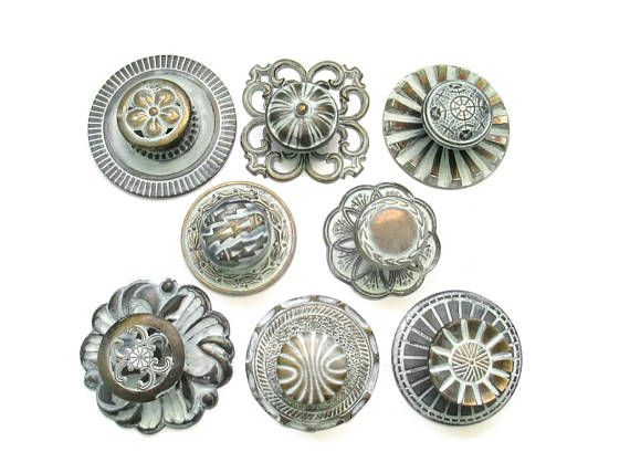 this listing is for a lot of 8 different vintage drawer knobs 1 or 2 might be slightly newer with 8 round backplates with all 8 screws all refinished in