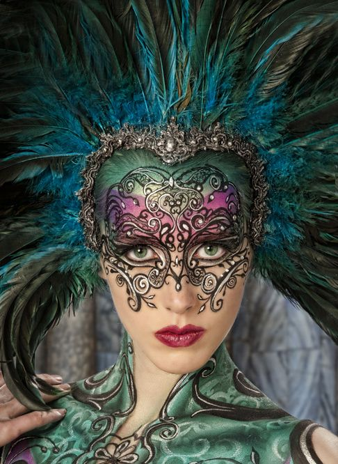 Colorful and detailed peacock inspired fantasy make-up with crystal accents.