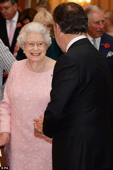 The Queen smiles at the Colombian president as she accompanies the visiting dignitary through the palace gallery