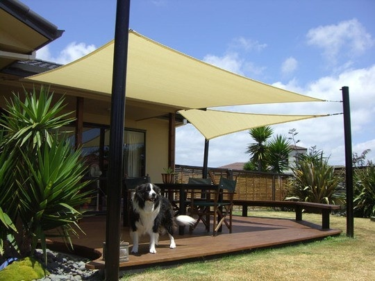 The style is totally different, but the components of this are what I want in my backyard:  a very low deck, posts + cloth or screen overhead for a very simple, light shade. Bench on one side.  Dog. s1ren