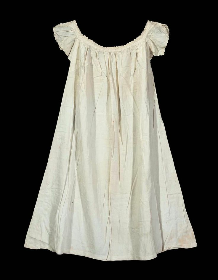 Worked by Marietta Carr Chester, for her wedding, June 19, 1862; wide square cut neck, short sleeves, sleeve edges and neck band embroidered with scalloped edges and design of minute stylized vine.