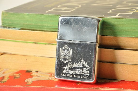 This authentic, collectible Zippo lighter, dates back to 1996. On the bottom it writes BRADFORD.PA. and on the one side of the logo it has a B and on the other a XII. In very good working condition. This Zippo is dedicated to the ship USS Mount Baker T-34.  *USNS Mount Baker (T-AE-34) is the seventh of eight Kilauea-class ammunition ships to serve with the Military Sealift Command. She is the second U.S. Navy ship to bear the name, and is named for Mount Baker, a 10,781-foot volcano in the…